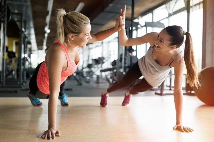two woman working on fitness