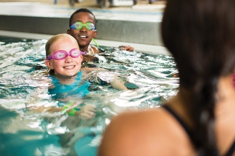 two children in swim lessons