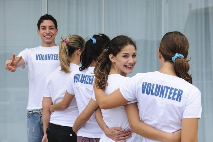 5 kids with volunteer shirts