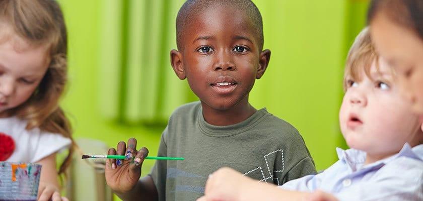 preschool children painting on green background